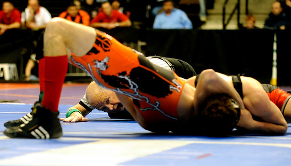 The referee checks to see if the shoulders of Erie's Austin Banks touch the ground during the 145-pound match against Centauri's Jared Holman during the first round of the 3A State Wrestling Tournament at the Pepsi Center in Denver, Thursday, Feb. 18, 2010. <br /> KASIA BROUSSALIAN