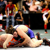 Erie's Clay Bunker (left) wrestles Salida's Donny Gocha for the 140-pound match during the first round of the 3A State Wrestling Tournament at the Pepsi Center in Denver, Thursday, Feb. 18, 2010. <br /> KASIA BROUSSALIAN