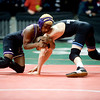 Boulder's Babalu Jones (left) wrestles Mountain Range's Keagan Lampo for the 103-pound match during the first round of the 5A State Wrestling Tournament at the Pepsi Center in Denver, Thursday, Feb. 18, 2010. <br /> KASIA BROUSSALIAN