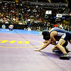 Lyon's Ryan Valadez (left) wrestles Olathe's Zach Stansberry for the 160-pound match during the first round of the 3A State Wrestling Tournament at the Pepsi Center in Denver, Thursday, Feb. 18, 2010. <br /> KASIA BROUSSALIAN