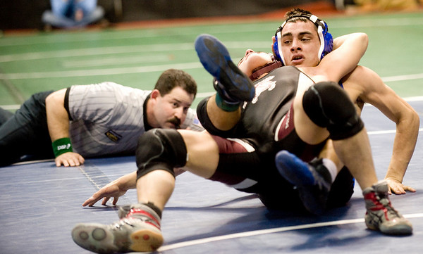 during the first round of the 3A State Wrestling Tournament at the Pepsi Center in Denver, Thursday, Feb. 18, 2010. <br /> KASIA BROUSSALIAN