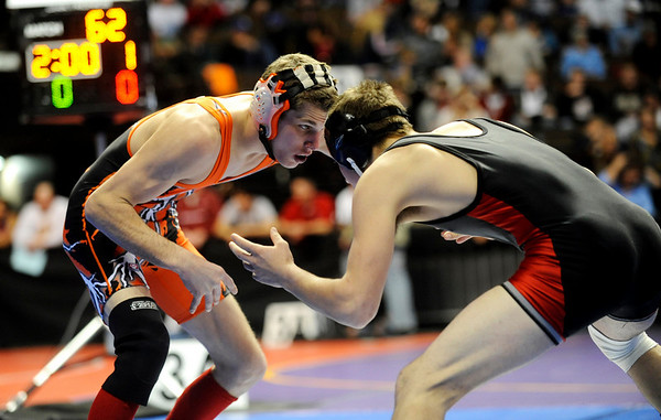 Erie's Austin Banks (left) wrestles Centauri's Jared Holman for the 145-pound match during the first round of the 3A State Wrestling Tournament at the Pepsi Center in Denver, Thursday, Feb. 18, 2010. <br /> KASIA BROUSSALIAN