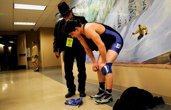 Lyons's Ryan Valadez is comforted by one of his coaches after losing his 160-pound match during the first round of the 3A State Wrestling Tournament at the Pepsi Center in Denver, Thursday, Feb. 18, 2010. <br /> KASIA BROUSSALIAN