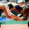 Boulder's Babalu Jones (right) wrestles Mountain Range's Keagan Lampo for the 103-pound match during the first round of the 5A State Wrestling Tournament at the Pepsi Center in Denver, Thursday, Feb. 18, 2010. <br /> KASIA BROUSSALIAN