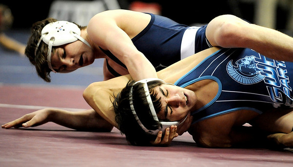 Broomfield's Courtland Hacker (top) gains more points on Greeley West's Roy Garza (bottom) in the 119 4A State Wrestling Quarter Finals in Denver, Colorado February 19, 2010.  CAMERA/Mark Leffingwell