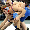 Boulder's Max Wessell (top) works to control Cherry Creek's Tanner Harms (bottom) during their 5A 189 State Wrestling Quarter Finals in Denver, Colorado February 19, 2010.  CAMERA/Mark Leffingwell