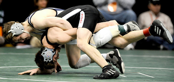Broomfield's Jerry Huff (left) controls  Roosevelt's C.J. York (right) during their 4A 125 State Wrestling Quarter Finals in Denver, Colorado February 19, 2010.  CAMERA/Mark Leffingwell
