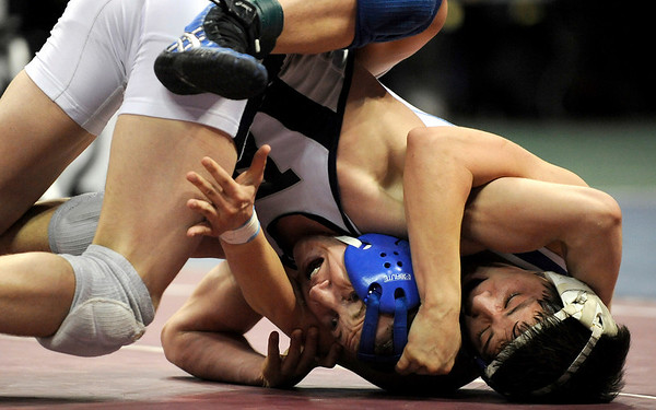 Broomfield's Nick Babcock (left) fights to get a reverse on Pueblo Central's Jaime Granillo (right) during their 4A 130 State Wrestling Quarter Finals in Denver, Colorado February 19, 2010.  CAMERA/Mark Leffingwell