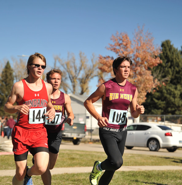 Ryan Patterson | The Sheridan Press<br /> From left: Sundance's Titus Schelling, Big Horn's Nathaniel Lydic and Noah Harvey race during the state cross-country meet at the Veteran Affairs Medical Center in Sheridan on Saturday, Oct. 20, 2018. The Rams placed third as a team in the 2A race.