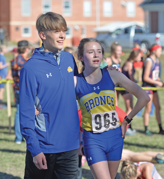 Bud Denega | The Sheridan Press<br /> Sheridan's Timothy Brown and twin sister Sylvia Brown walk after the finish of the girls 4A race during the state cross-country meet at the Sheridan Veterans Affairs Medical Center Saturday, Oct. 20, 2018.