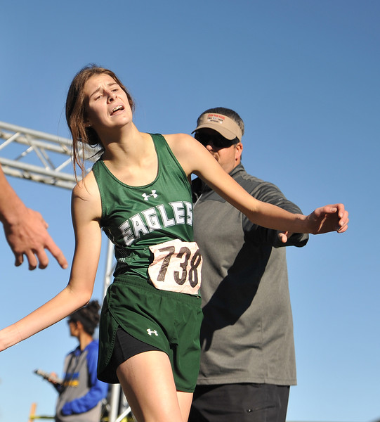 Ryan Patterson | The Sheridan Press<br /> Tongue River's Macey McArthur crosses the finish line during the state cross-country meet at the Veteran Affairs Medical Center in Sheridan on Saturday, Oct. 20, 2018. The Lady Eagles placed fifth as a team in the 2A race.