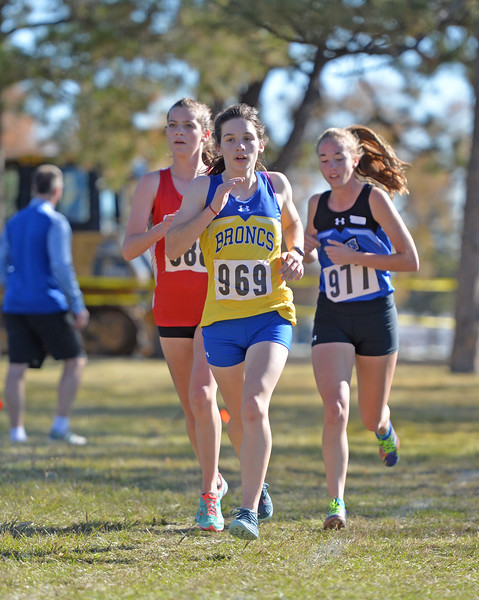 Bud Denega | The Sheridan Press<br /> Sheridan's Kate Moran leads a pack of runners during the state cross-country meet at the Sheridan Veterans Affairs Medical Center Saturday, Oct. 20, 2018.