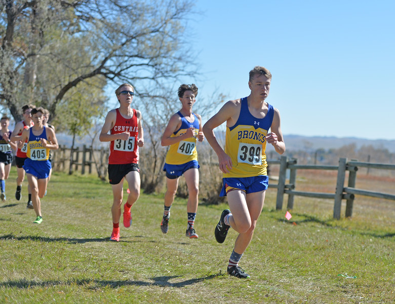 Bud Denega | The Sheridan Press<br /> Sheridan's Garett Avery leads a pack of runners during the state cross-country meet at the Sheridan Veterans Affairs Medical Center Saturday, Oct. 20, 2018.