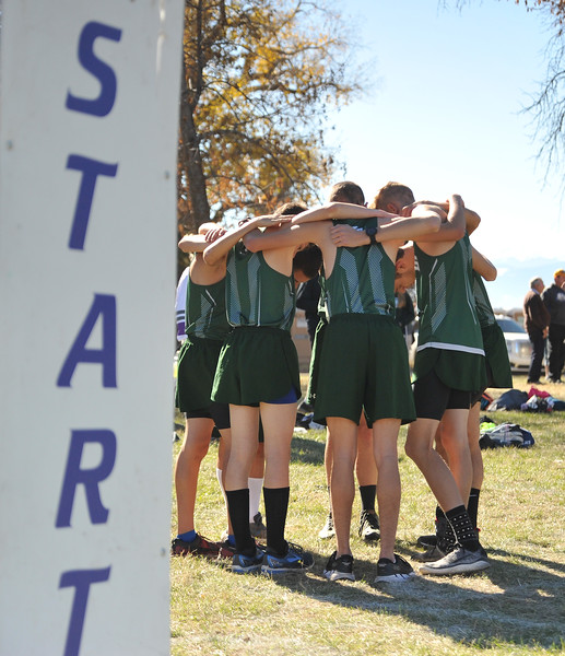 Ryan Patterson | The Sheridan Press<br /> The Tongue River boys team huddles before its race during the state cross-country meet at the Veteran Affairs Medical Center in Sheridan on Saturday, Oct. 20, 2018. The Eagles took fourth as a team in the 2A race.