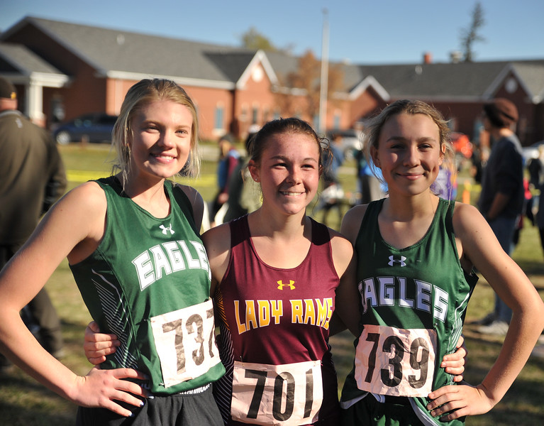Ryan Patterson | The Sheridan Press<br /> From left: Tongue River's Kalie Bocek, Big Horn's Elizabeth Foley and Tongue River's Chloe Wilson smile after their race during the state cross-country meet at the Veteran Affairs Medical Center in Sheridan on Saturday, Oct. 20, 2018.