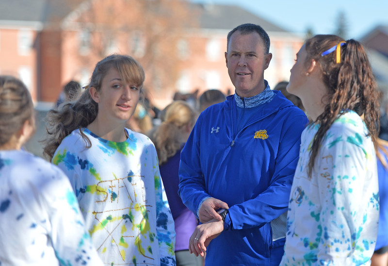 Bud Denega | The Sheridan Press<br /> Sheridan High School head coach Art Baures talks with his girls team during the state cross-country meet at the Sheridan Veterans Affairs Medical Center Saturday, Oct. 20, 2018.