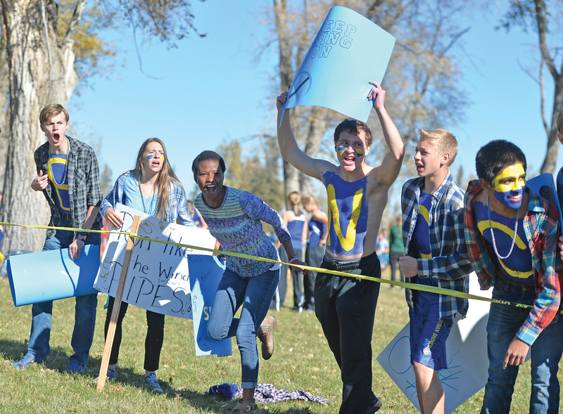 Bud Denega | The Sheridan Press<br /> Members of the Sheridan High School cross-country team cheer during the state cross-country meet at the Sheridan Veterans Affairs Medical Center Saturday, Oct. 20, 2018.