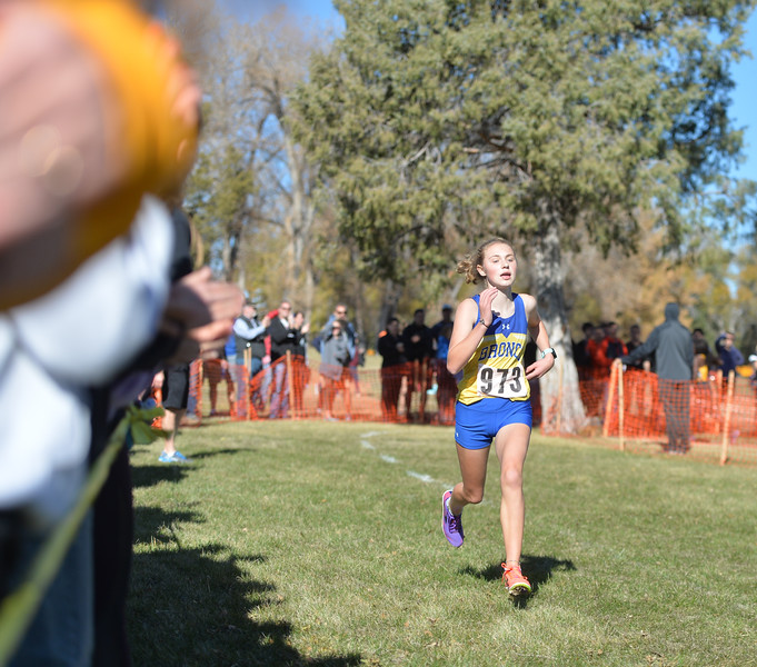 Bud Denega | The Sheridan Press<br /> Sheridan's Katie Turpin runs toward the finish line during the state cross-country meet at the Sheridan Veterans Affairs Medical Center Saturday, Oct. 20, 2018.