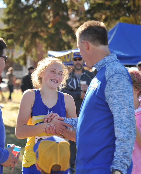 Ryan Patterson | The Sheridan Press<br /> Sheridan's Katie Turpin smiles with head coach Art Baures after her race during the state cross-country meet at the Veteran Affairs Medical Center in Sheridan on Saturday, Oct. 20, 2018. The Lady Broncs took fifth as a team.