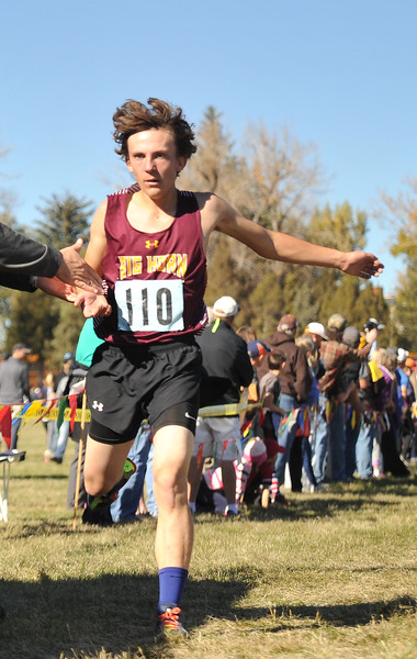 Ryan Patterson | The Sheridan Press<br /> Big Horn's Billy Watson crosses the finish line during the state cross-country meet at the Veteran Affairs Medical Center in Sheridan on Saturday, Oct. 20, 2018. The Rams placed third as a team in the 2A race.
