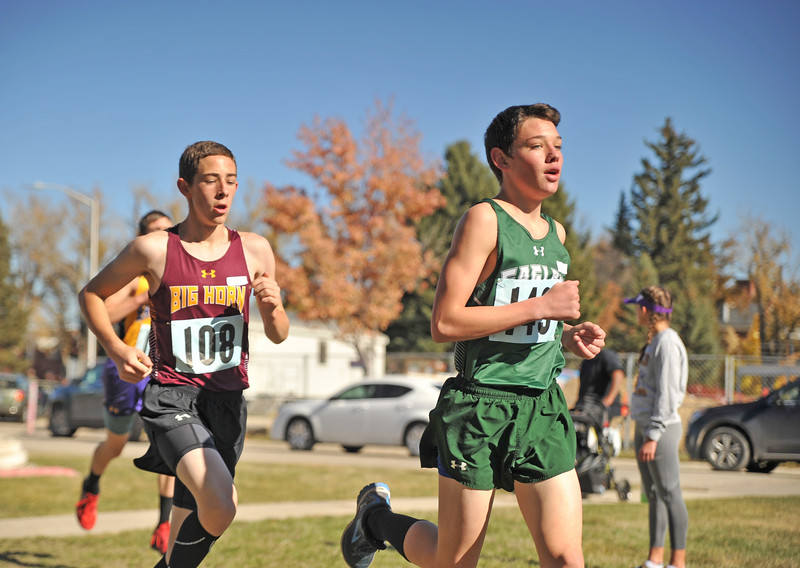 Ryan Patterson | The Sheridan Press<br /> Big Horn's Bridger Michaud, left, and Tongue River's Azariah Benevides race during the state cross-country meet at the Veteran Affairs Medical Center in Sheridan on Saturday, Oct. 20, 2018. The Rams took third and the Eagles took fourth in the 2A race.