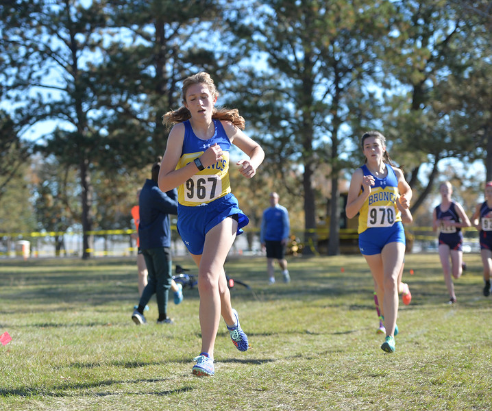 Bud Denega | The Sheridan Press<br /> Sheridan's Sarah Gonda leads a pack of runners during the state cross-country meet at the Sheridan Veterans Affairs Medical Center Saturday, Oct. 20, 2018.