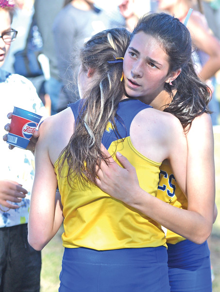 Bud Denega | The Sheridan Press<br /> Sheridan's Piper O'Dell hugs Sylvia Brown during the state cross-country meet at the Sheridan Veterans Affairs Medical Center Saturday, Oct. 20, 2018.