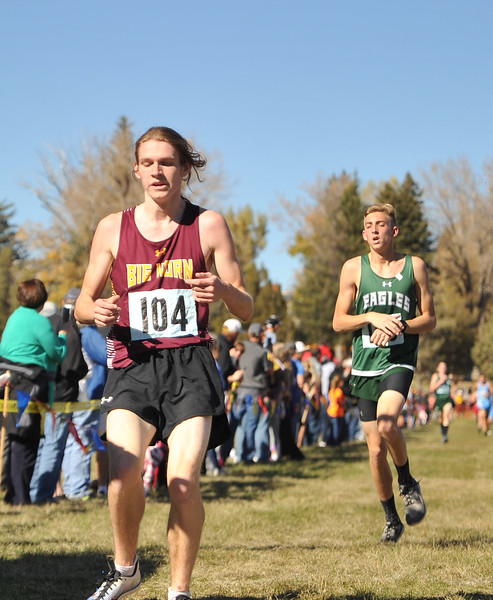 Ryan Patterson | The Sheridan Press<br /> Big Horn's Kobie Cummins, left, and Tongue River's Jett Walker cross the finish line during the state cross-country meet at the Veteran Affairs Medical Center in Sheridan on Saturday, Oct. 20, 2018. The Rams took third and the Eagles took fourth in the 2A race.
