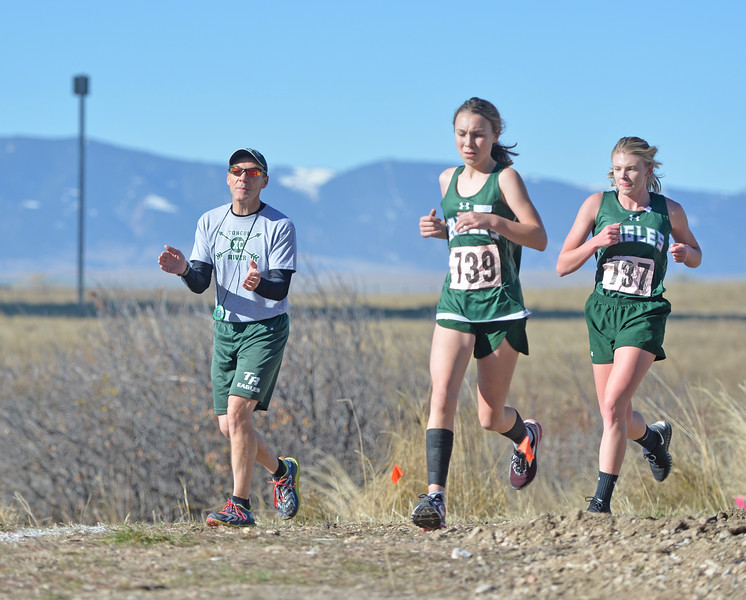 Bud Denega | The Sheridan Press<br /> Tongue River's Chloe Wilson leads a pack of runners during the state cross-country meet at the Sheridan Veterans Affairs Medical Center Saturday, Oct. 20, 2018.
