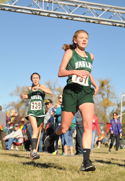Ryan Patterson | The Sheridan Press<br /> Tongue River's Kalie Bocek, right, and Chloe Wilson cross the finish line during the state cross-country meet at the Veteran Affairs Medical Center in Sheridan on Saturday, Oct. 20, 2018. The Lady Eagles took fifth as a team in the 2A race.