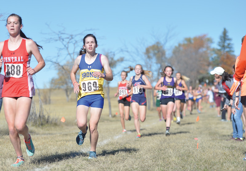 Bud Denega | The Sheridan Press<br /> Sheridan's Kate Moran battles for position during the state cross-country meet at the Sheridan Veterans Affairs Medical Center Saturday, Oct. 20, 2018.