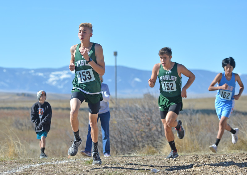 Bud Denega | The Sheridan Press<br /> Tongue River's Jett Walker leads a pack of runners during the state cross-country meet at the Sheridan Veterans Affairs Medical Center Saturday, Oct. 20, 2018.