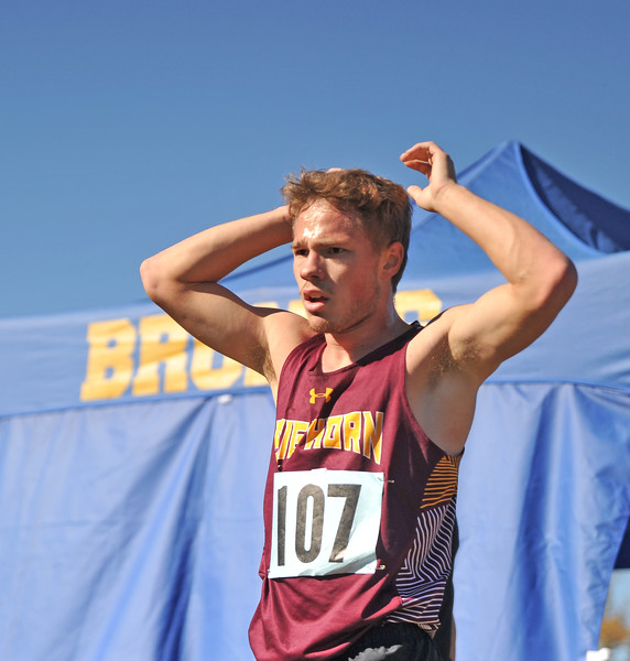 Ryan Patterson | The Sheridan Press<br /> Big Horn's Nathaniel Lydic reacts after finishing his race during the state cross-country meet at the Veteran Affairs Medical Center in Sheridan on Saturday, Oct. 20, 2018. The Rams took third as a team in the 2A race.