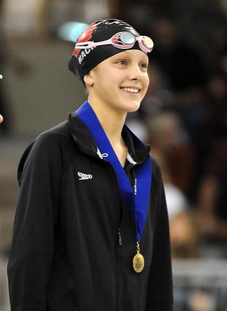 Pat Christman<br /> Mankato West's Chantal Nack smiles on the podium after winning the State Class A 200-yard freestyle championship Wednesday.