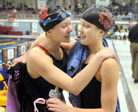 Pat Christman<br /> Sisters Danielle (left) and Chantal Nack embrace after Chantals victory in the State Class A 500-yard freestyle finals Wednesday at the University of Minnesota Aquatic Center. The pair won four individual state championships between them and swam on Mankato West's championship 200-yard freestyle relay team.