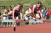 Science Hill runner Nicole Hardin (winner of event) and Dobyns Bennett runner (who I belived finished second) clear the hurdle at the same time during the girls 1500meter Sttplechase. Photo by Ned Jilton II