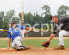 East Wake baserunner Andrew Haugh (31) heads for home on a wild pitch as Corinth pitcher Kody Daniels tries to cover. Photo by Dean Strickland OD.