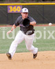 Pirate SS Robbie Story (14) tracks down an East Wake infileld hit. Photo by Dean Strickland OD.