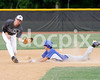 Corinth 2B Jacob Rowe gets the throw a little late to stop East Wake's Erik Pittard from turning his lead off hit into a double. Photo by Dean Strickland OD.