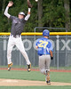 Corinth 1B Austin Vickers (1) goes high in an attempt to stop an errant throw as East Wake runner Toney Castleberry heads to first. Photo by Dean Strickland OD.