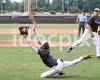 Pirate 1B Austin Vickers (1)  makes an acrobatic attempt to field a pop foul  as pitcher Sam Berman(34) backs him up.