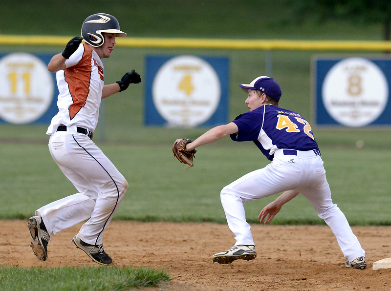 Bob Raines--Montgomery Media<br /> Morelanders' Kevin Walder catches Warminster'sCole Browne off the bag at second base June 19, 2015.