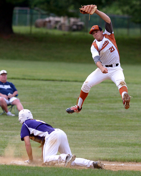 Bob Raines--Montgomery Media<br /> Morelanders' Kyle Irwin is safe at third as Warmintster's Tim Brodhag has to leap for a throwJune 19, 2015.