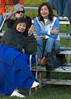 Moms and aunts cheer from the sidelines.