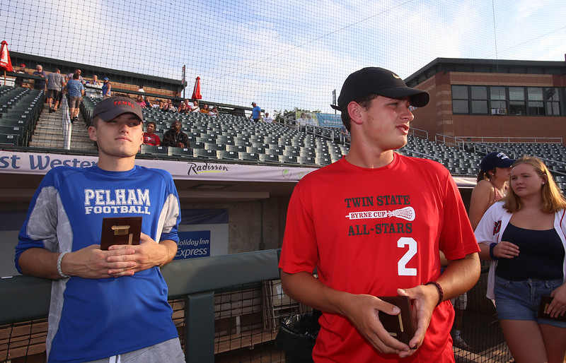 Sun All Stars honored at LeLacheur Park before Spinners game. Pelham football All Star Brett Lindsay, left, and Pelham lacrosse All Star Manny Baisley. (SUN/Julia Malakie)
