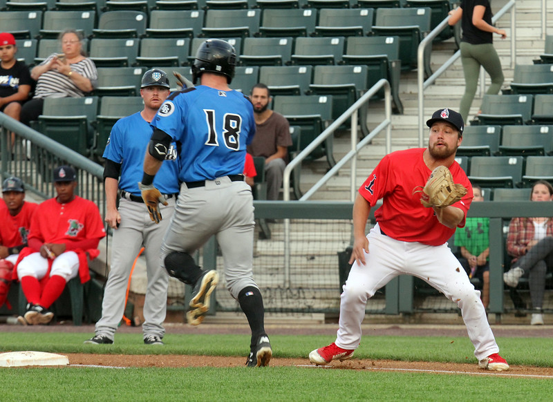 Lowell Spinners vs Hudson Valley Renegades baseball. Renegades' Hill Alexander (18) is safe at first as Spinners first baseman Stephen Scott is pulled off the base in the first inning. (SUN/Julia Malakie)