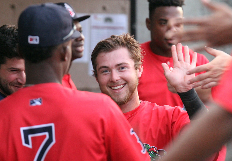 Lowell Spinners vs Hudson Valley Renegades baseball. Spinners' Cameron Cannon (50) greeted in dugout after scoring in the first inning. (SUN/Julia Malakie)