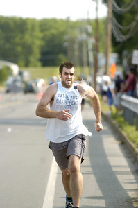 Joe Andretta sprints hard along the home stretch as he finishes the Sunbury YMCA's 5k race on Saturday morning.
