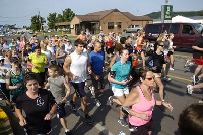 Runners take off at the start of Saturday's Sunbury YMCA 5k race.