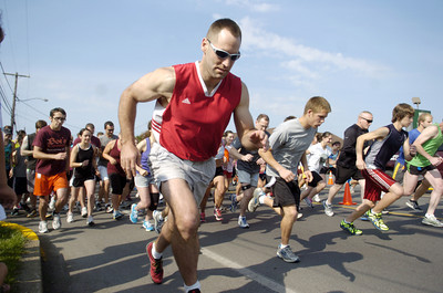 Jeffrey Walter, center, leads the way out of the gate during Saturday's Sunbury YMCA 5k race.